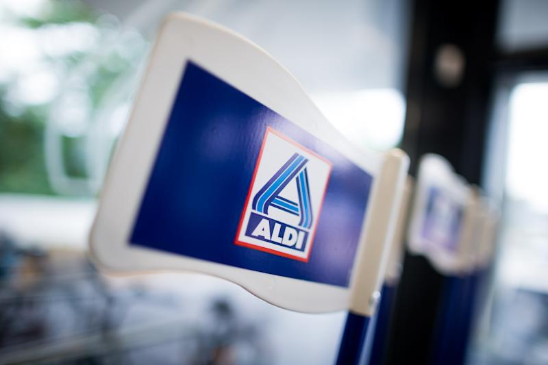 Flags carrying the logo of Aldi Nord seen in a newly designed Aldi Nord store in Gladbeck,Germany, 20 September 2016. Discount supermarket chainAldi presented the Aldi Nord (lit. Aldi North) supermarket of the future as a blueprint for future stores. Photo: Rolf Vennenbernd/dpa   usage worldwide (Photo by Rolf Vennenbernd/picture alliance via Getty Images)