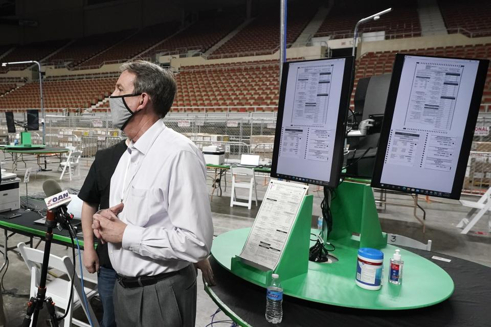 FILE - In this Thursday, April 22, 2021, file photo, former Arizona Secretary of State Ken Bennett speaks at a news conference to talk about overseeing a 2020 election ballot audit ordered by the Republican lead Arizona Senate at the Arizona Veterans Memorial Coliseum in Phoenix. A judge hearing a challenge to voter privacy policies during the Republican-controlled Arizona Senate's recount of 2.1 million 2020 election ballots says he is not convinced voter secrecy is being upheld. (AP Photo/Ross D. Franklin, File)