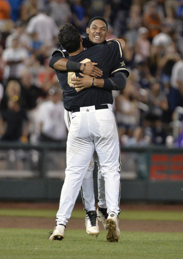 Vanderbilt's John Norwood, rear, and Zander Wiel celebrate after Vanderbilt defeated Virginia 3-2 in the deciding game of the best-of-three NCAA baseball College World Series finals in Omaha, Neb., Wednesday, June 25, 2014. (AP Photo/Ted Kirk)