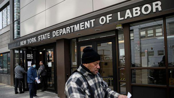 PHOTO: Visitors to the Department of Labor are turned away at the door by personnel due to closures over coronavirus concerns in New York, March 18, 2020. (John Minchillo/AP, FILE)