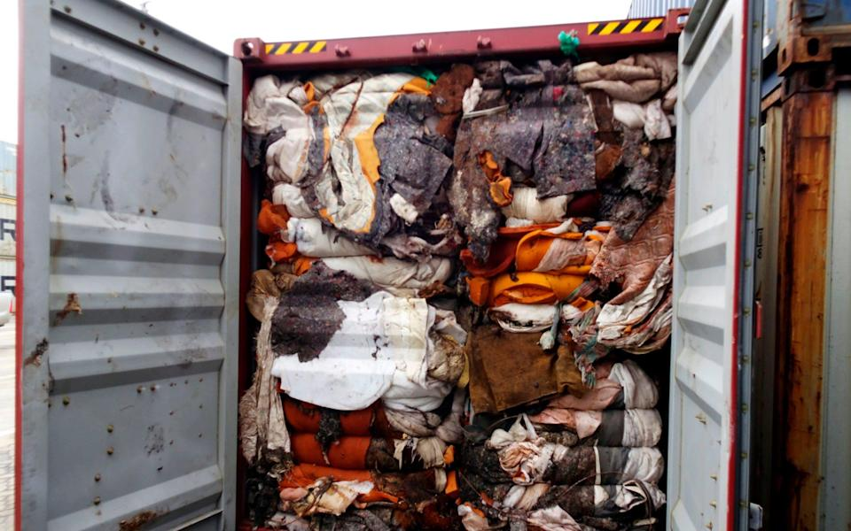 One of the containers opened in Sri Lanka which reportedly contains human remains originating from the UK - AFP