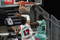 Charlotte Hornets guard Terry Rozier (3) dunks while being fouled by Chicago Bulls guard Garrett Temple (17) during the second half of an NBA basketball game in Charlotte, N.C., Friday, Jan. 22, 2021. (AP Photo/Jacob Kupferman)