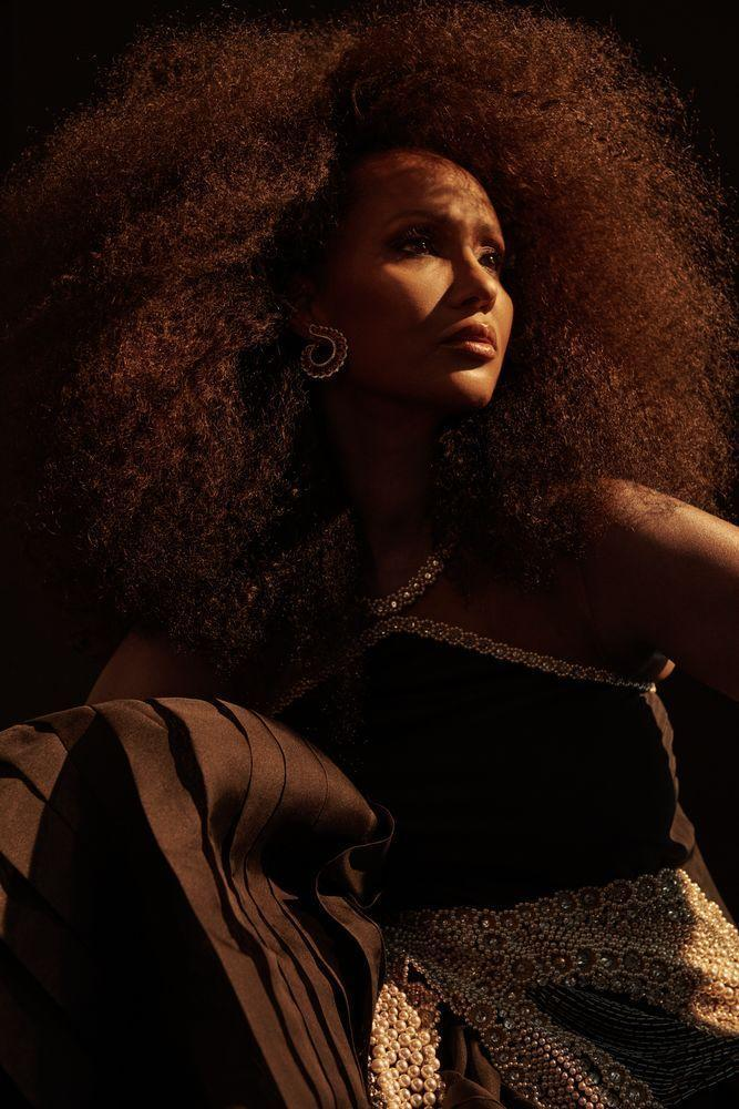 Photo credit: Iman wears Lanvin dress and Chopard earrings, photographed by Paola Kudacki