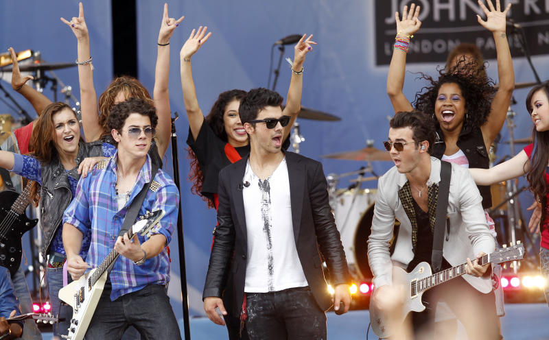 "FILE - This Aug. 13, 2010 file photo shows The Jonas Brothers, from left, Nick Jonas, Joe Jonas and Kevin Jonas, performing during ABC's ""Good Morning America"" television program in New York. The band announced Tuesday, Oct. 19, 2013, they're ending their highly successful run. The news comes after the brothers abruptly canceled their tour over creative differences earlier this month. (AP Photo/Jason DeCrow, File)"