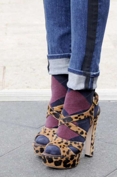 A fashion week attendee wears socks and sandals with style.