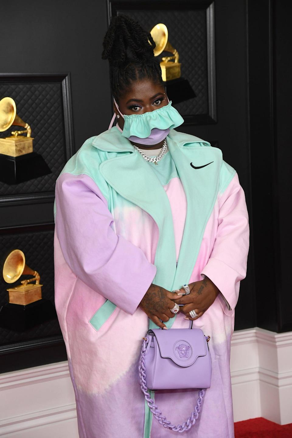 <p>Wearing a custom Nike x Meals set and mask with a Versace bag.</p>