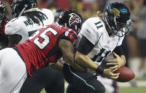 Atlanta Falcons defensive end John Abraham (55) hits Jacksonville Jaguars quarterback Blaine Gabbert (11) to cause a fumble during the first half of an NFL football game Thursday, Dec. 15, 2011, in Atlanta. (AP Photo/John Bazemore)