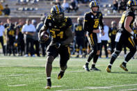 Missouri running back Larry Rountree III scores on a touchdown run during the second half of an NCAA college football game against Arkansas Saturday, Dec. 5, 2020, in Columbia, Mo. (AP Photo/L.G. Patterson)