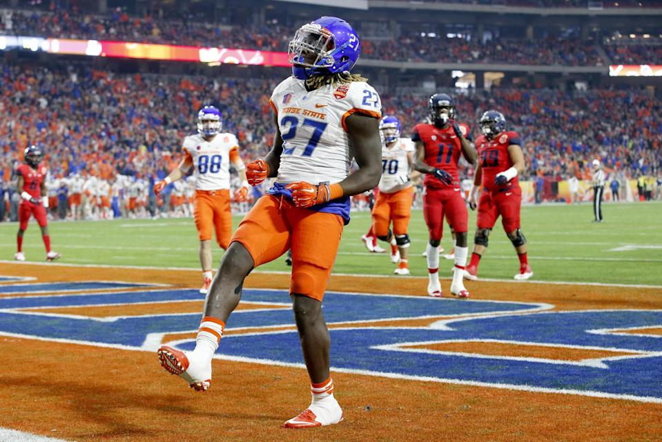 Boise State running back Jay Ajayi (27) celebrates his touchdown against Arizona during the first half of the Fiesta Bowl NCAA college football game, Wednesday, Dec. 31, 2014, in Glendale, Ariz. (AP Photo/Ross D. Franklin)