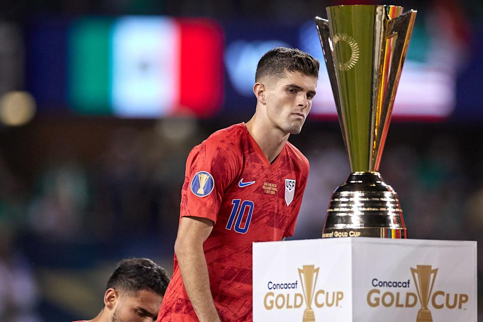 CHICAGO, IL - JULY 07: United States midfielder Christian Pulisic (10) stares at the 2019 Gold Cup Trophy after the CONCACAF Gold Cup final match between the United States and Mexico on July 07, 2019, at Soldier Field in Chicago, IL. (Photo by Robin Alam/Icon Sportswire via Getty Images)