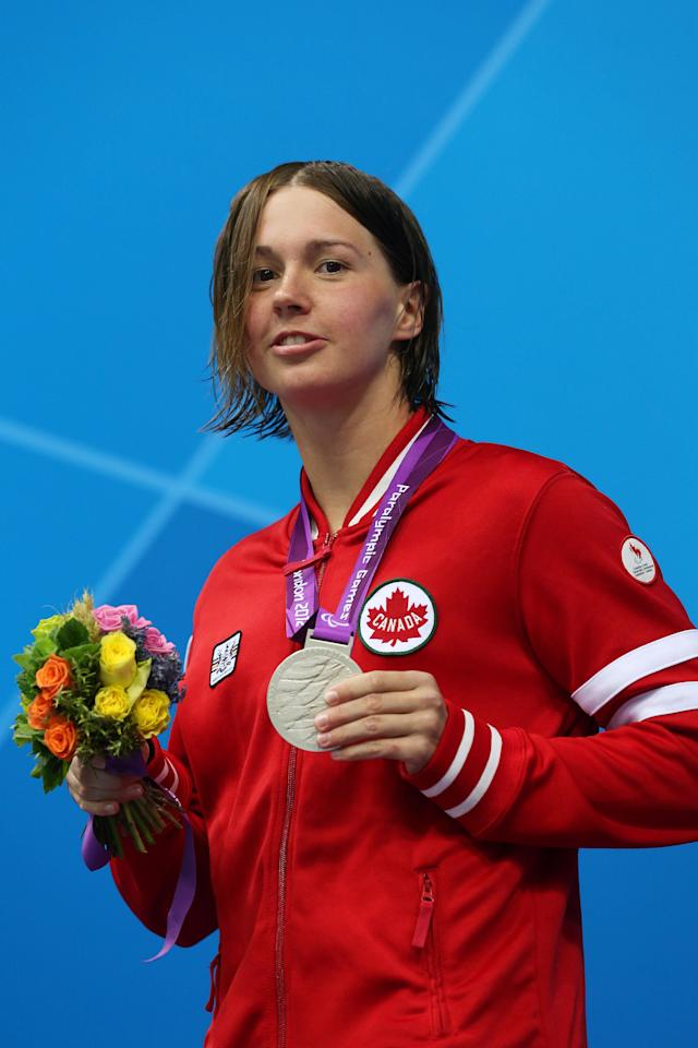 LONDON, ENGLAND - AUGUST 31: Silver medallist Brianna Nelson of Canada poses on the podium during the medal ceremony for the Women's 50m Butterfly - S7 Final on day 2 of the London 2012 Paralympic Games at Aquatics Centre on August 31, 2012 in London, England. (Photo by Clive Rose/Getty Images)