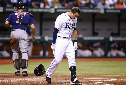 Tampa Bay Rays' Evan Longoria tosses down his helmet as he reacts after striking out swinging to Minnesota Twins starting pitcher Samuel Deduno to end the third inning of a baseball game Monday, July 8, 2013, in St. Petersburg, Fla. (AP Photo/Brian Blanco)