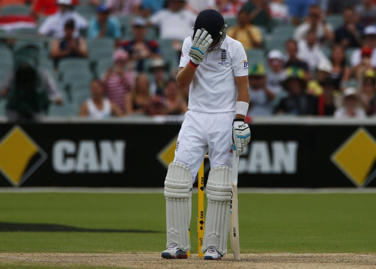 England's Joe Root reacts after his dismissal during the fourth day's play in the second Ashes cricket test against Australia at the Adelaide Oval December 8, 2013. REUTERS/David Gray (AUSTRALIA - Tags: SPORT CRICKET)