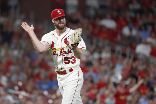 St. Louis Cardinals relief pitcher John Gant celebrates after getting Cincinnati Reds' Jose Iglesias to ground into a double play to end the top of the eighth inning in the second baseball game of a doubleheader Saturday, Aug. 31, 2019, in St. Louis. (AP Photo/Jeff Roberson)