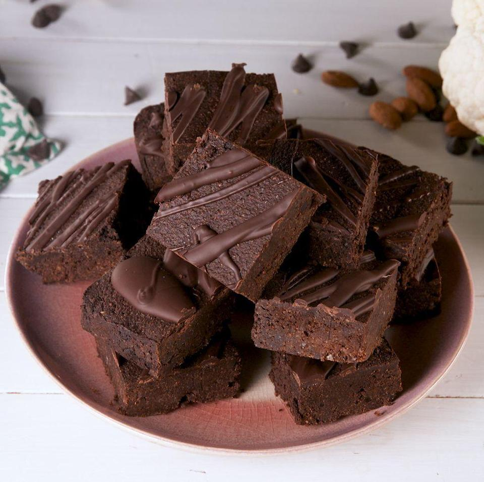 "<p>To make these <a href=""https://www.delish.com/uk/cooking/recipes/g30136955/chocolate-brownie-recipe/"" rel=""nofollow noopener"" target=""_blank"" data-ylk=""slk:brownies"" class=""link rapid-noclick-resp"">brownies</a> perfectly fudgy, you'll need cauliflower puree: Pulse cauliflower florets in a food processor until the mixture is very smooth and almost paste-like. Riced cauliflower won't do here; you need a much finer consistency, so you don't taste chunks of cauliflower in the brownie. </p><p>Get the <a href=""https://www.delish.com/uk/cooking/recipes/a35137329/keto-cauliflower-brownies-recipe/"" rel=""nofollow noopener"" target=""_blank"" data-ylk=""slk:Keto Cauliflower Brownies"" class=""link rapid-noclick-resp"">Keto Cauliflower Brownies</a> recipe.</p>"