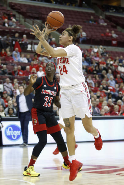 Ohio State guard Kierstan Bell shoots next to Louisville guard Jazmine Jones during the second half of an NCAA college basketball game in Columbus, Ohio, Thursday, Dec. 5, 2019. (AP Photo/Paul Vernon)