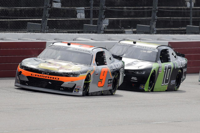 Noah Gragson (9) leads Ross Chastain (10) during the NASCAR Xfinity series auto race Thursday, May 21, 2020, in Darlington, S.C. (AP Photo/Brynn Anderson)