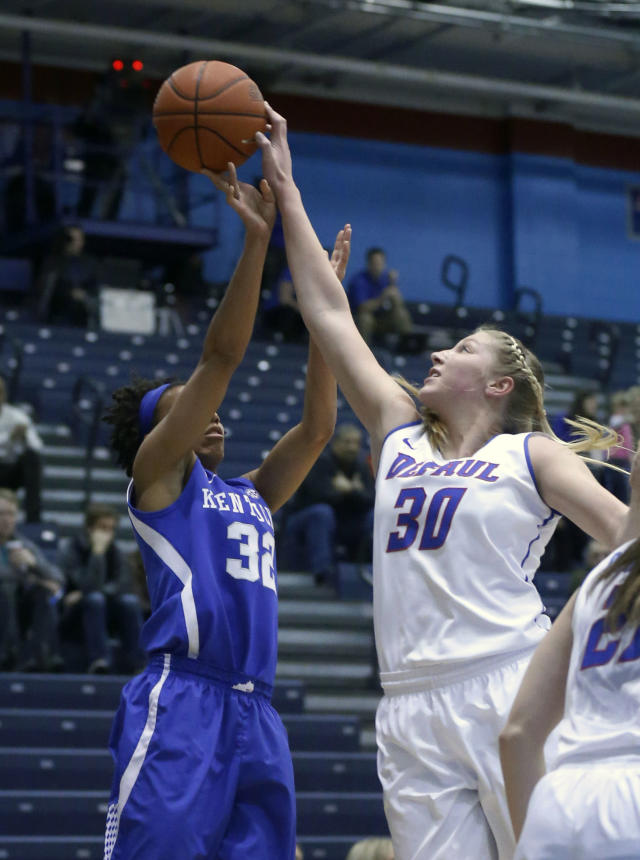 DePaul forward Megan Podkowa (30) blocks the shot of Kentucky guard Kastine Evans during the first half of an NCAA college basketball game Thursday, Dec. 12, 2013, in Chicago. (AP Photo/Charles Rex Arbogast)