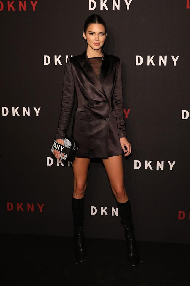 """<p>For last night's <a href=""""https://www.donnakaran.com/category/dkny.do"""" target=""""_blank"""">DKNY</a> party, Kendall Jenner did the most Fashion Week thing ever: stepped out wearing absolutely no pants. She wore a longline satin blazer as a dress, then added some square-toe boots and a <a href=""""https://www.donnakaran.com/product/ebony+mesh+camera+bag.do?sortby=ourPicksAscend&page=2&from=fn&selectedOption=566108"""" target=""""_blank"""">mesh camera bag</a> – that, FYI, is <a href=""""https://www.donnakaran.com/product/ebony+mesh+camera+bag.do?sortby=ourPicksAscend&page=2&from=fn&selectedOption=566108"""" target=""""_blank"""">currently on sale for $79</a>. This is officially the most supermodel look I've ever seen.</p>"""