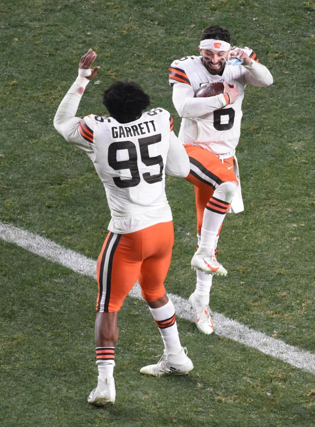 Cleveland Browns quarterback Baker Mayfield and defensive end Myles Garrett celebrate after the 2020 AFC Wild Card playoff game against the Pittsburgh Steelers at Heinz Field. (Philip G. Pavely/USA TODAY Sports)