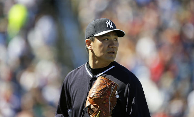 New York Yankees pitcher Masahiro Tanaka walks off the field after pitching in the fifth inning of an exhibition baseball game against the Philadelphia Phillies Saturday, March 1, 2014, in Tampa, Fla. (AP Photo/Charlie Neibergall)