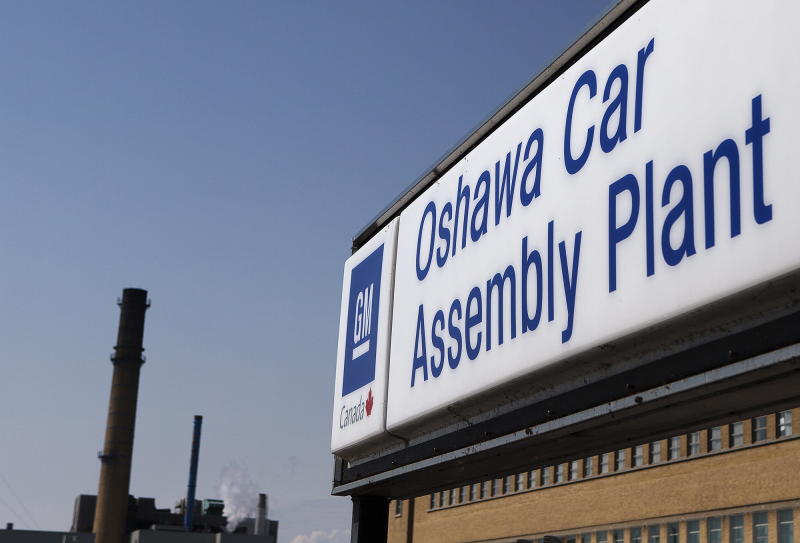 FILE - In this Monday, Sept. 17, 2012, file photo, a sign stands outside Oshawa's General Motors car assembly plant in Oshawa, Canada. General Motors says it has received $11 billion in credit lines from 35 financial institutions in 14 countries, boosting its available cash and credit to more than $42 billion.  The company wouldn't say specifically what it plans to do with the money.   (AP Photo/The Canadian Press, Michelle Siu, File)