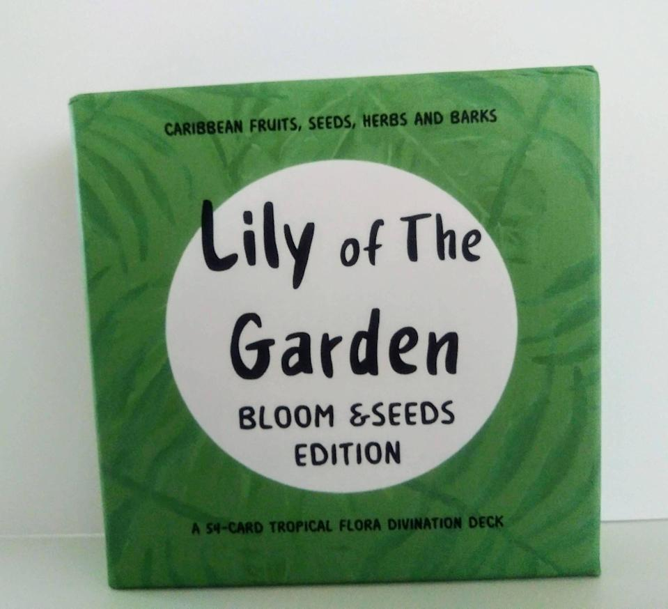 """<p><strong>Indie Deck Hub</strong></p><p>IndieDeckHub.com</p><p><strong>$60.00</strong></p><p><a href=""""https://indiedeckhub.com/collections/oracle/products/lily-of-the-garden-bloom-and-seeds-oracle-deck"""" rel=""""nofollow noopener"""" target=""""_blank"""" data-ylk=""""slk:Shop Now"""" class=""""link rapid-noclick-resp"""">Shop Now</a></p><p>This 54-card deck, created by West Indian artist the Hurricane Mystic, features flowers, fruits, trees, and other plants from the region, along with a message—like """"Golden Apple: Prosperity awaits you."""" </p>"""