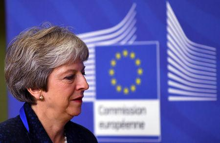 British PM May arrives at European Commission headquarters to discuss draft agreements on Brexit, in Brussels