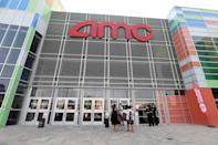 <p>People enter AMC Town Square 18 on August 20 in Las Vegas, Nevada.</p>