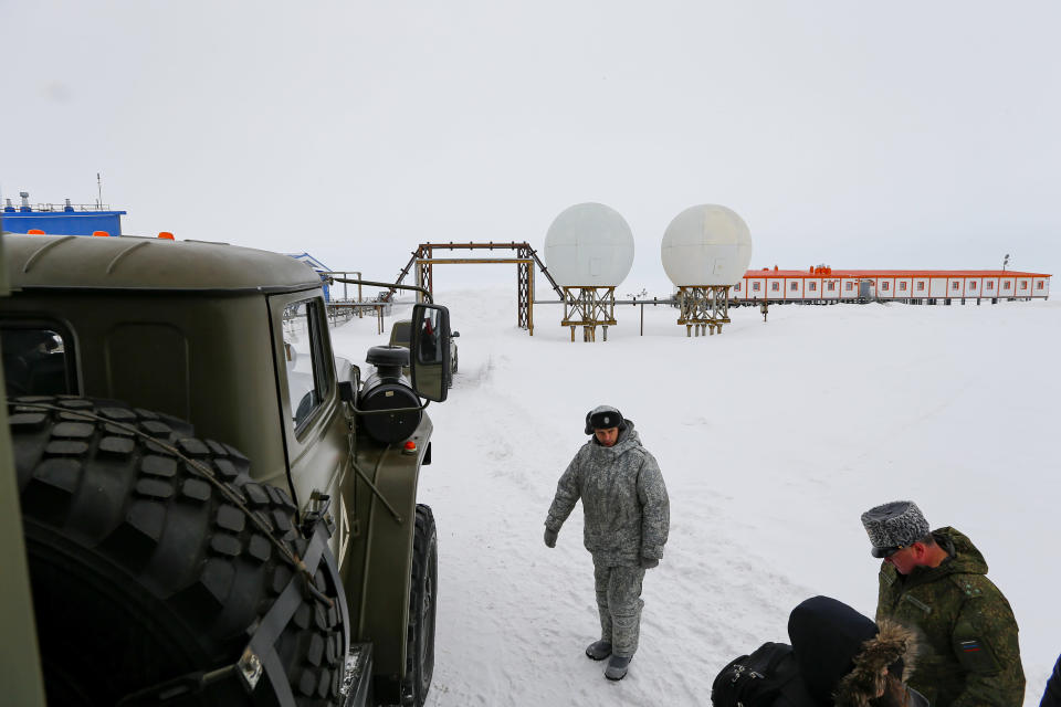 Soldiers stand at a radar facility on the Alexandra Land island near Nagurskoye, Russia, Monday, May 17, 2021. Once a desolate home mostly to polar bears, Russia's northernmost military outpost is bristling with missiles and radar and its extended runway can handle all types of aircraft, including nuclear-capable strategic bombers, projecting Moscow's power and influence across the Arctic amid intensifying international competition for the region's vast resources. (AP Photo/Alexander Zemlianichenko)