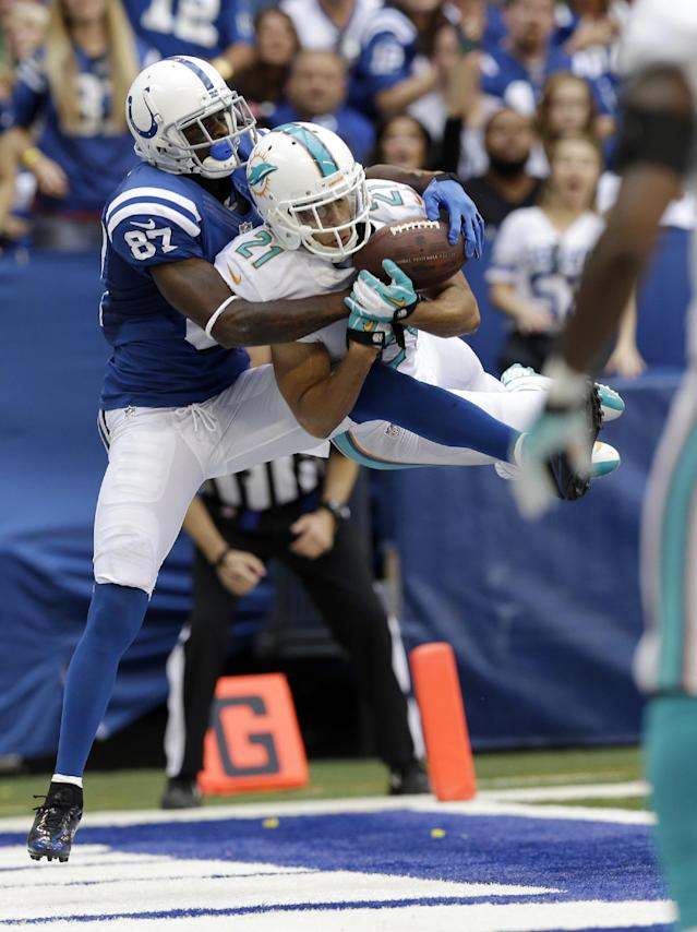 Miami Dolphins' Brent Grimes (21) intercepts a pass in the end zone intended for Indianapolis Colts' Reggie Wayne (87) during the second half an NFL football game Sunday, Sept. 15, 2013, in Indianapolis. (AP Photo/Michael Conroy)