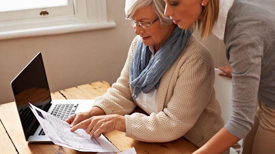 senior woman receiving help with her finances