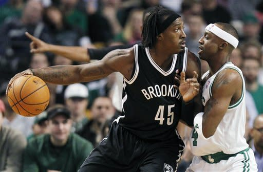 Brooklyn Nets' Gerald Wallace (45) looks to move against Boston Celtics' Jason Terry, right, in the first quarter of an NBA basketball game in Boston, Wednesday, Nov. 28, 2012. (AP Photo/Michael Dwyer)