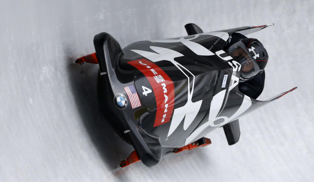 Steven Holcomb and Curtis Tomasevicz of the United States speed down the track during his first run of the 2-man Bobsled World Cup race in Koenigssee, southern Germany, on Saturday, Jan. 25, 2014. (AP Photo/Matthias Schrader)