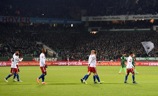 Soccer Football - Bundesliga - Werder Bremen vs Hamburger SV - Weser-Stadion, Bremen, Germany - February 24, 2018 Hamburg and Werder Bremen players walk off at half time REUTERS/Fabian Bimmer DFL RULES TO LIMIT THE ONLINE USAGE DURING MATCH TIME TO 15 PICTURES PER GAME. IMAGE SEQUENCES TO SIMULATE VIDEO IS NOT ALLOWED AT ANY TIME. FOR FURTHER QUERIES PLEASE CONTACT DFL DIRECTLY AT + 49 69 650050