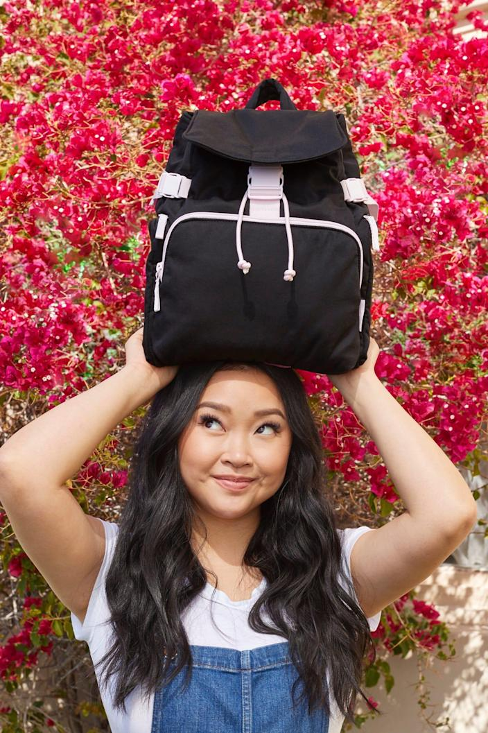 Lana Condor posing with the Lana Utility Backpack that she designed as part of her collaboration with Vera Bradley.