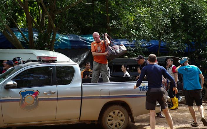 Vernon Unsworth, in orange, pictured during the rescue of the 12 Thai trapped schoolboys - REUTERS