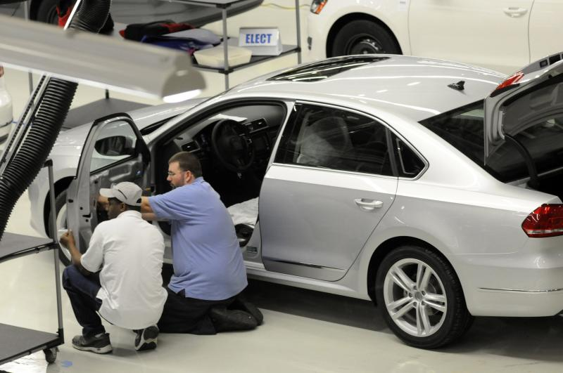 File photo of Volkswagen employees inspecting a Passat in the assembly finish department in Chattanooga Tennessee