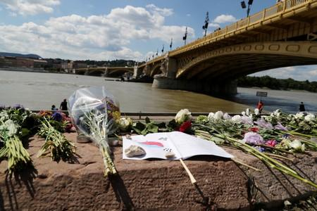 FILE PHOTO: Flowers are seen placed next to the Margaret bridge in respect for the victims from a boat carrying South Korean tourists capsized on the Danube river, in Budapest