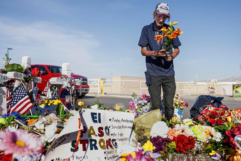 Antonio Basco, whose wife, Margie Reckard, was one of 22 killed by a gunman at a local Walmart, lays flowers in her honor at a makeshift memorial near the scene on August 16, 2019, in El Paso, Texas. (Photo: Sandy Huffaker via Getty Images)