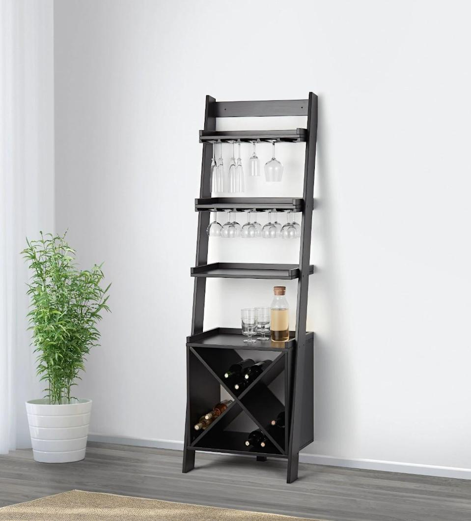 "<p>The small <a href=""https://www.popsugar.com/buy/Hoghem%20Bar%20Shelf-447023?p_name=Hoghem%20Bar%20Shelf&retailer=ikea.com&price=199&evar1=casa%3Aus&evar9=46151613&evar98=https%3A%2F%2Fwww.popsugar.com%2Fhome%2Fphoto-gallery%2F46151613%2Fimage%2F46152213%2FHoghem-Bar-Shelf&list1=shopping%2Cikea%2Corganization%2Ckitchens%2Chome%20shopping&prop13=api&pdata=1"" rel=""nofollow noopener"" target=""_blank"" data-ylk=""slk:Hoghem Bar Shelf"" class=""link rapid-noclick-resp"">Hoghem Bar Shelf</a> ($199) might be compact, but it still offers more than enough room for wine bottles, glasses, and cocktail supplies.</p>"