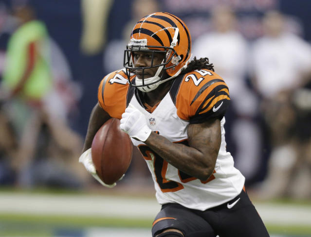 FILE - In this Jan. 5, 2013, file photo, Cincinnati Bengals' Adam Jones runs the ball against the Houston Texans during an NFL wild card playoff football game in Houston. Veteran cornerback Adam Pacman Jones signed a one-year contract with the Denver Broncos, Sunday, Aug. 26, 2018. The 35-year-old Jones had his best NFL seasons while Broncos current head coach Vance Joseph was his secondary coach with the Cincinnati Bengals. (AP Photo/Eric Gay, File)