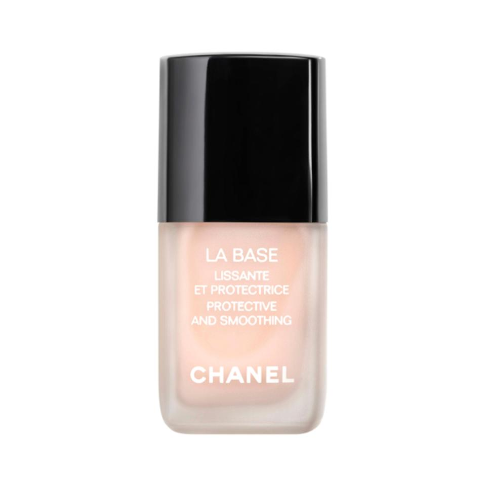 """<h3>Chanel La Base Protective And Smoothing<br></h3><br>If you're loyal to Chanel's signature glossy Le Vernis polish formula, you'll want to invest in La Base — a nourishing serum that smooths and safeguards nails with a blend of vitamin E and argan oil.<br><br><strong>Chanel</strong> La Base Protective And Smoothing, $, available at <a href=""""https://go.skimresources.com/?id=30283X879131&url=https%3A%2F%2Fwww.violetgrey.com%2Fproduct%2Fla-base-protective-and-smoothing%2FCHN-158190"""" rel=""""nofollow noopener"""" target=""""_blank"""" data-ylk=""""slk:Violet Grey"""" class=""""link rapid-noclick-resp"""">Violet Grey</a>"""