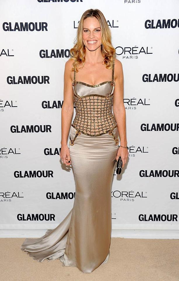 "Also wearing Atelier Versace was Hilary Swank, though her caged gold bodice gown with its wrinkled midsection looked a little less than fabulous. <a href=""http://www.wireimage.com"" target=""new"">WireImage.com</a> - November 8, 2010"