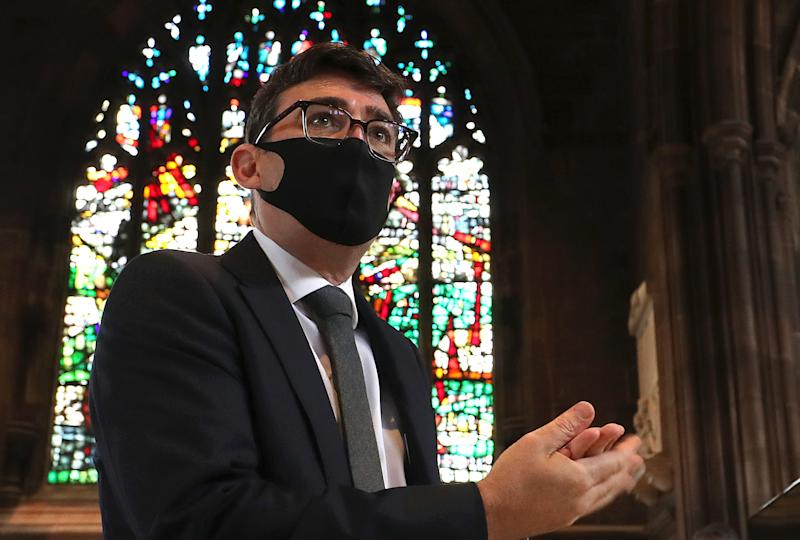 MANCHESTER, UNITED KINGDOM - JULY 16: Rt. Hon. Andy Burnham, Mayor of Greater Manchester, sanitises his hands before a memorial service for the victims of coronavirus at Manchester Cathedral on July 16, 2020 in Manchester, United Kingdom. The service was held with social distancing measures and streamed online to honour those who have died of COVID-19. More than 45,000 people have died across the UK as after testing positive for the disease. (Photo by Martin Rickett -WPA Pool/Getty Images)