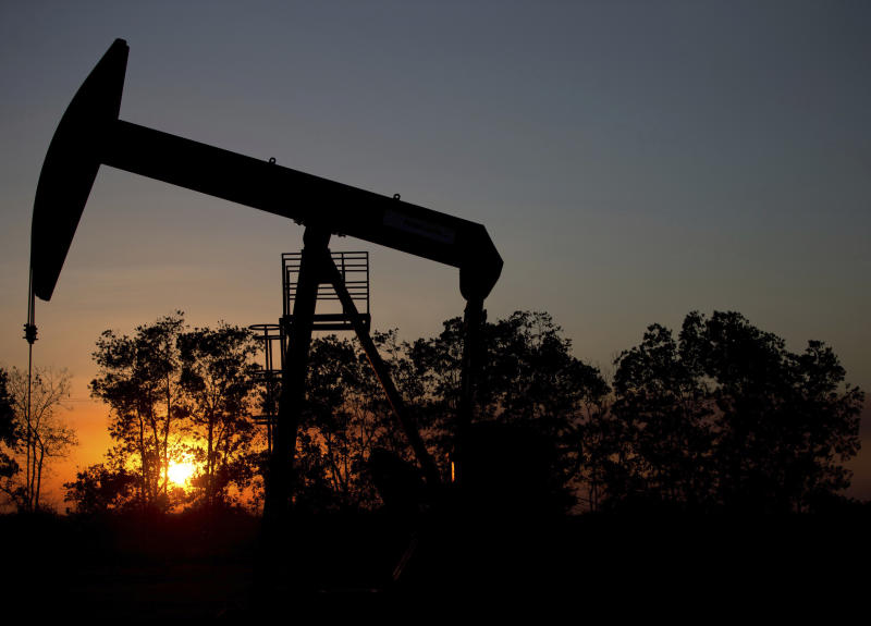 The Latest: OPEC agrees to increase oil production