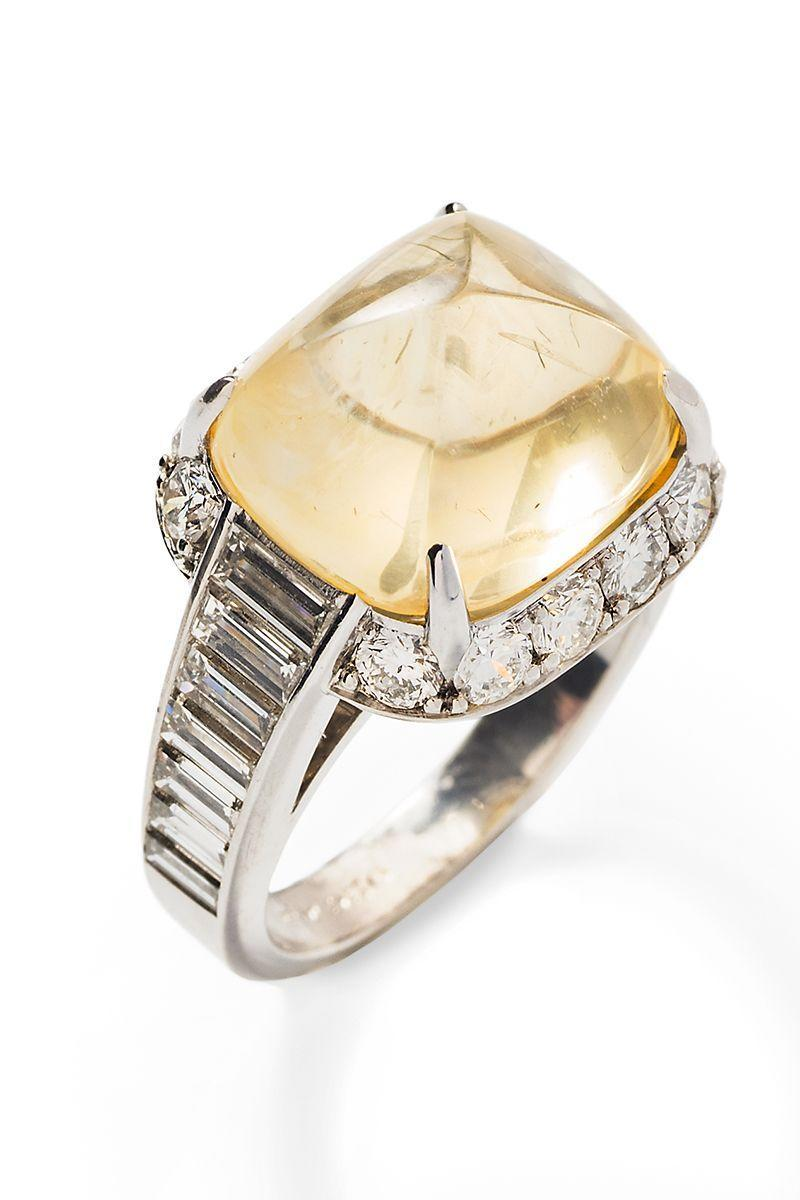 "<p><em><strong>Tiina Smith</strong> Pyramidal Canary Yellow Cabochon Sapphire and Diamond Ring, $25,500, <a href=""https://tiinasmithjewelry.com/collections/vintage-rings/products/pyramidal-cabochon-yellow-sapphire-and-diamond-ring-no-heat?variant=24144889151588"" rel=""nofollow noopener"" target=""_blank"" data-ylk=""slk:tiinasmithjewelry.com"" class=""link rapid-noclick-resp"">tiinasmithjewelry.com</a></em></p><p><a class=""link rapid-noclick-resp"" href=""https://tiinasmithjewelry.com/collections/vintage-rings/products/pyramidal-cabochon-yellow-sapphire-and-diamond-ring-no-heat?variant=24144889151588"" rel=""nofollow noopener"" target=""_blank"" data-ylk=""slk:SHOP"">SHOP</a></p>"