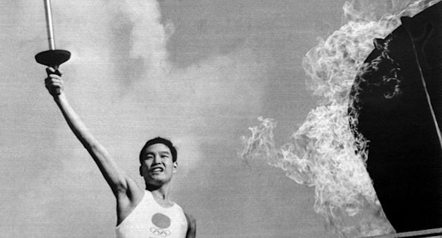 Yoshinori Sakai lights the Olympic flame at the opening of the Olympic Games in 1964
