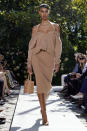 The Michael Kors Spring/Summer 2022 collection is modeled during Fashion Week in New York, Friday, Sept. 10, 2021. (AP Photo/Richard Drew)