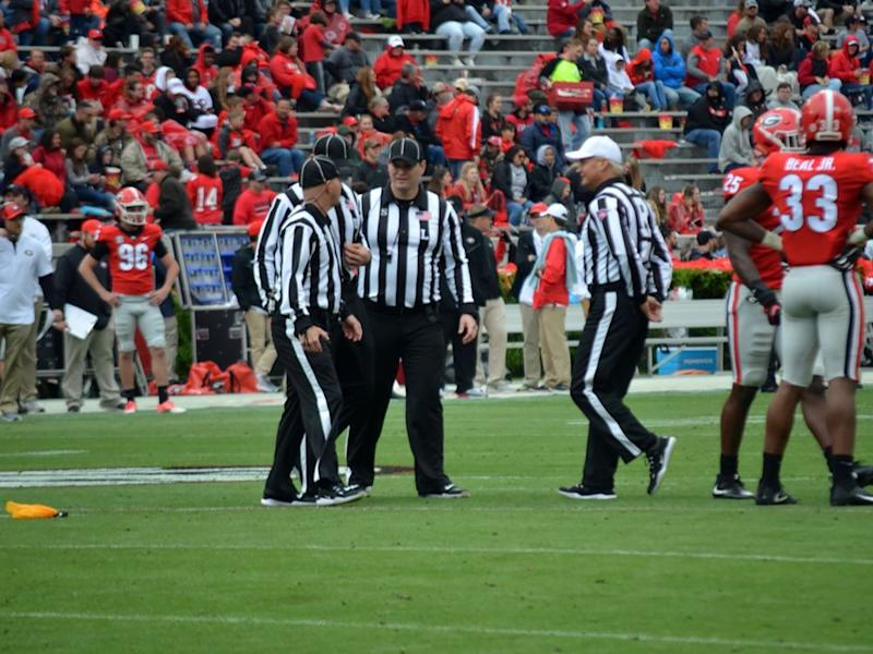 A beautiful flag toss was marred by an awful pass interference call. | Gary McGriff/Southeastern Conference